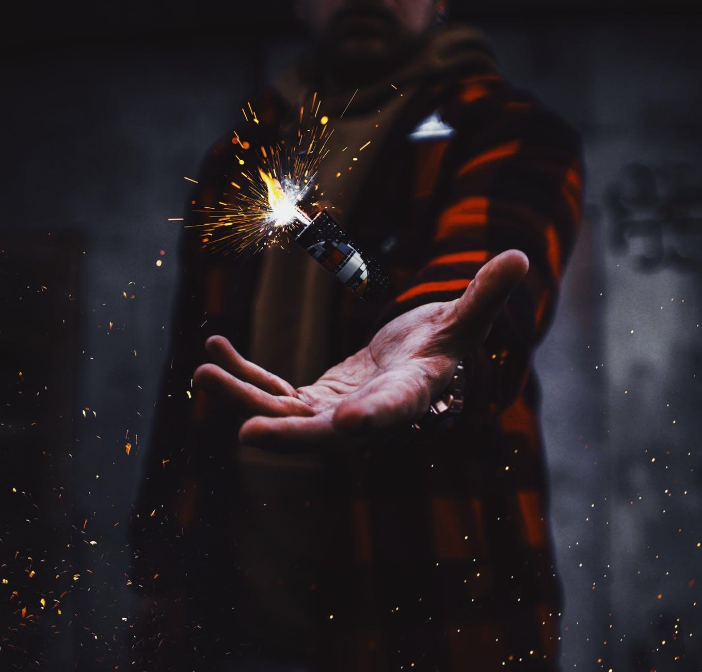 person tossing firecracker